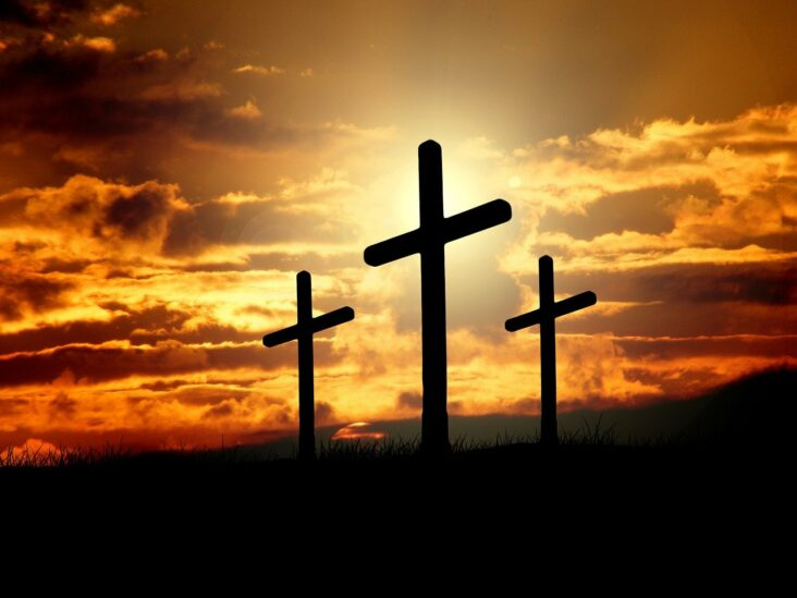 Three crosses in the sunset.